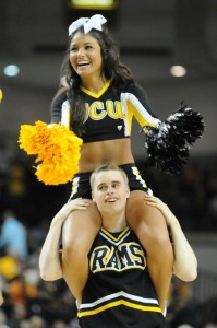 VCU cheerleader, Taylor Silva, gets a ride to her car following a VCU win.