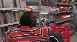 """Weber catches a ride in a shopping guard while hanging with the Boys & Girls Club at this past December's """"Shop With the Rams"""" event."""