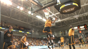 Freshman Justin Tillman goes up for one of his several power finishes of the evening.