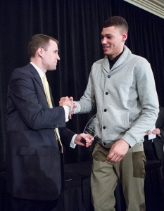 Michael Gilmore accepted this year's Appreciation Award from new head coach, Will Wade.