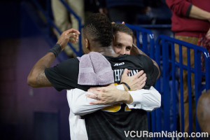 Wade hugs senior guard Melvin Johnson after a huge road win at Richmond.